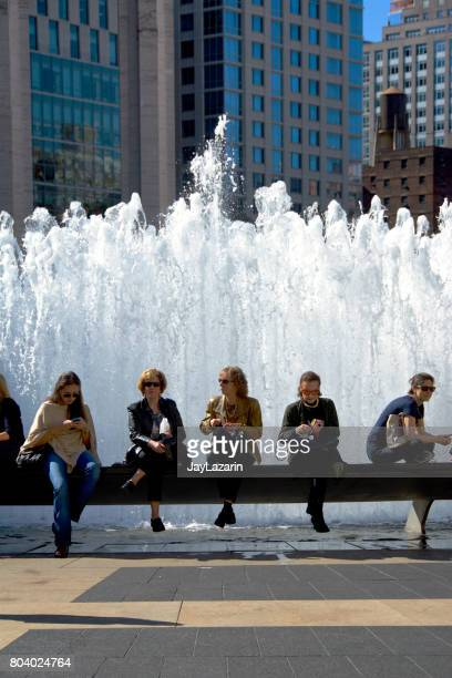urban cultural life, new york city, usa. women waiting for a matinee performance outside lincoln center, upper west side, manhattan. - the theater lincoln center stock photos and pictures