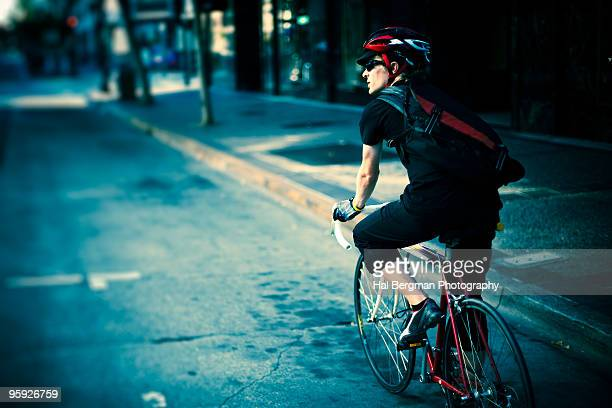urban cyclist - bicycle messenger stock pictures, royalty-free photos & images
