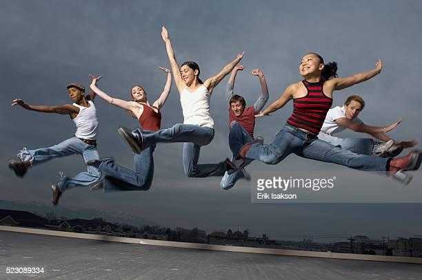 Urban dancers in mid-air
