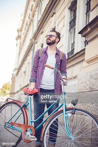 urban feeling with bicycle - hairy man stock pictures, royalty-free photos & images