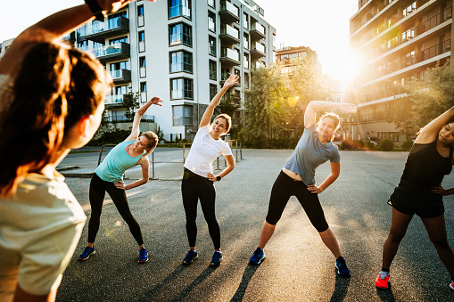 Urban Fitness Group Warming Up For Run - gettyimageskorea
