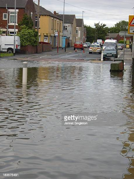 Urban flooding caused by torrential rain in June 2007 renders our street in Agbrigg, Wakefield impassable. Police block the road leaving me stranded...