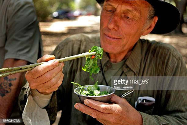 Urban forager Christopher Nyerges tastes a salad he prepared from wild food found in Hahamongna Watershed Park.