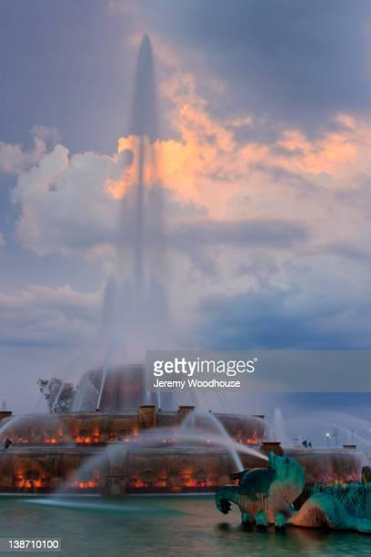 Urban fountain spraying water at night