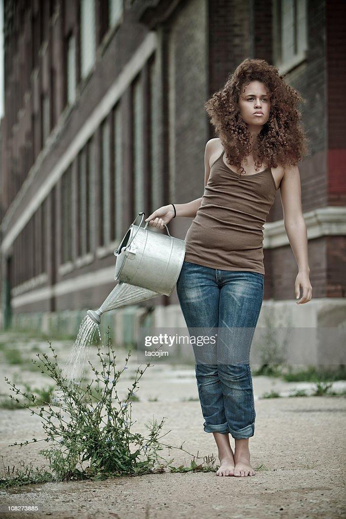 Urban Gardener - Watering a Weed
