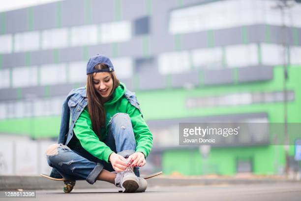urban girl is prepairing for skateboard ride - lace glove stock pictures, royalty-free photos & images