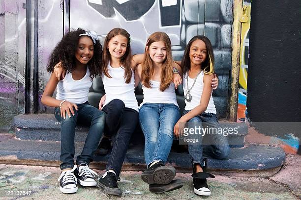 Urban girls sitting on steps