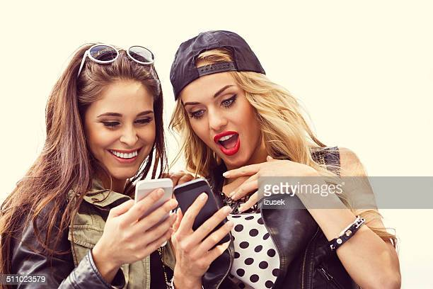 urban girls using smart phones - izusek stock pictures, royalty-free photos & images