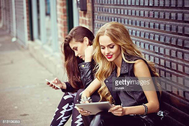 urban girls using technologies - izusek stock pictures, royalty-free photos & images