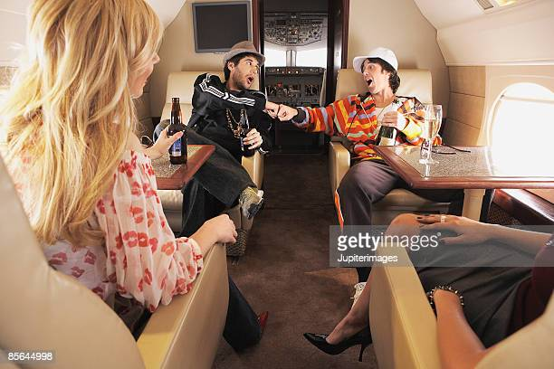 Urban hipsters and women on private airplane