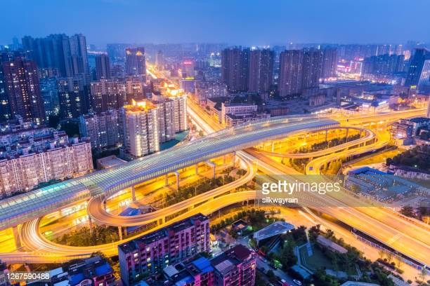 urban interchange at night - wuhan stock pictures, royalty-free photos & images