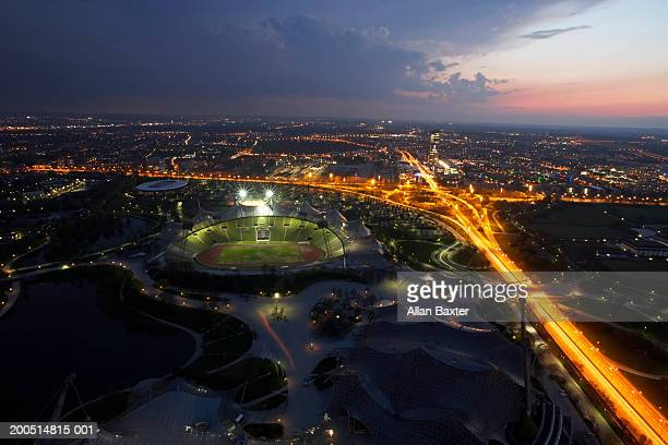 urban landscape at dusk with stadium and well-lit streets, elevated view - liberty stadion stock-fotos und bilder