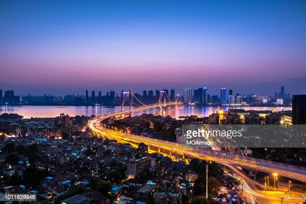 urban landscape in wuhan,china - wuhan stock photos and pictures