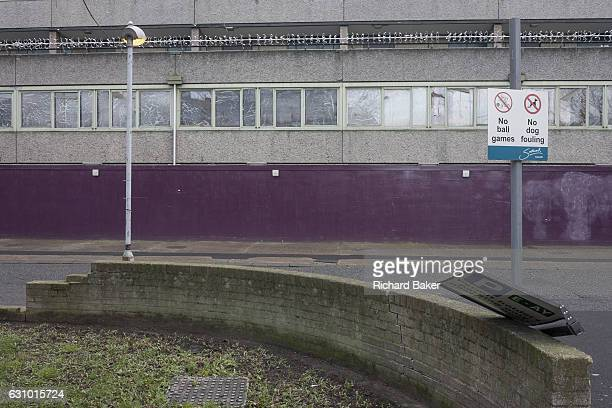 Urban landscape of a curved wall street signs and security fencing on the Aylesbury Estate on 4th January London borough of Southwark England