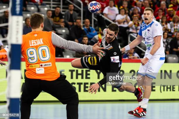 Urban Lesjak of Slovenia is challenged by Hendrik Pekeler of Germany during the Men's Handball European Championship Group C match between Slovenia...