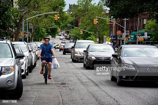 Urban Life, New York City, Male Bicyclist Near Vehicles, Brooklyn