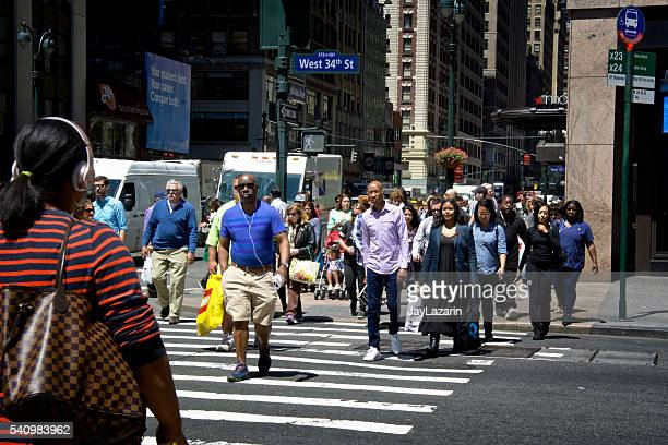 Urban Life, New York City, Pedestrians Walking across Manhattan Intersection