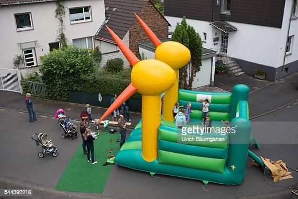 Urban life street festival in the district of Bonn Plittersdorf Children in a bouncy castle