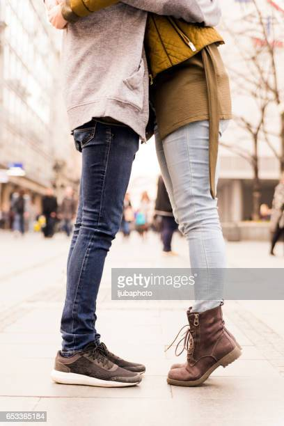 urban love, couple kissing - leg kissing stock photos and pictures