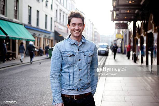 urban male in city street - denim jacket stock pictures, royalty-free photos & images