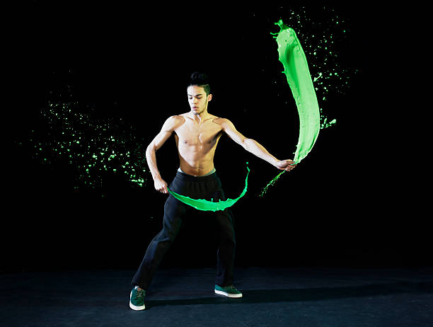urban man dancing with paint splashes