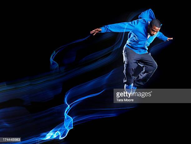urban man jumping with light trails - light trail stock pictures, royalty-free photos & images