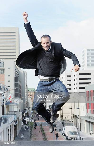 Urban man leaping with joy.