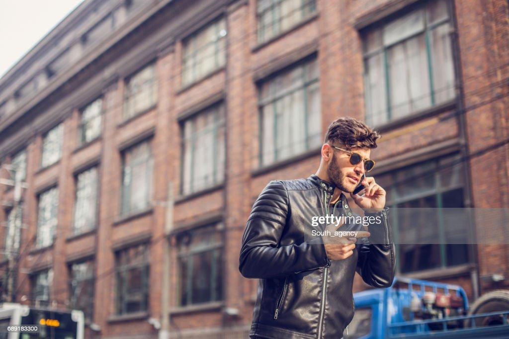 Urban man on the phone : Stock Photo