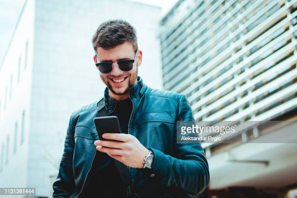 urban man taking a selfie - baby mobile stock photos and pictures