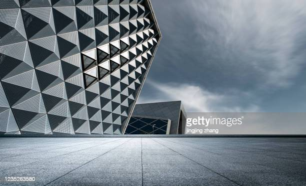 urban marble square with tall city and pyramid shape protruding from the side of three-dimensional building - architecture stock pictures, royalty-free photos & images