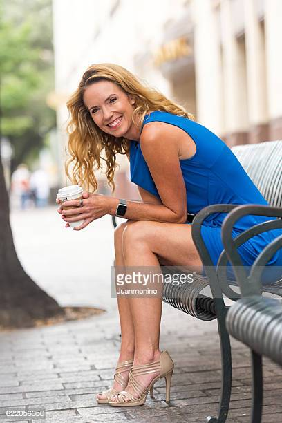 urban mature blond woman - slim stock pictures, royalty-free photos & images
