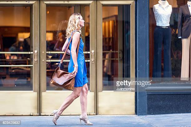 urban mature blond woman - sleeveless dress stock pictures, royalty-free photos & images