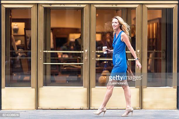 urban mature blond woman - one mature woman only stock pictures, royalty-free photos & images
