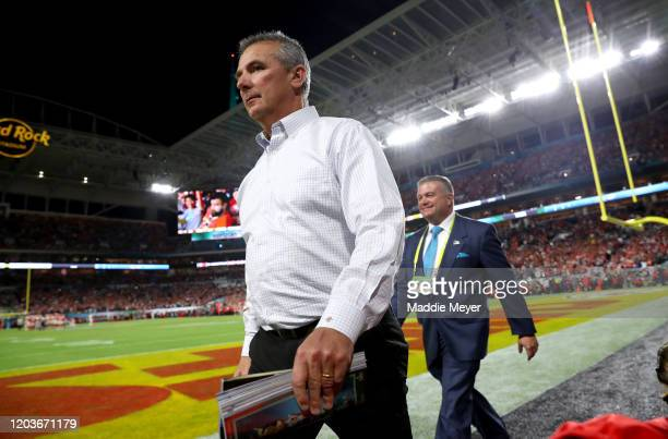 Urban Meyer walks on the field in Super Bowl LIV at Hard Rock Stadium on February 02, 2020 in Miami, Florida.