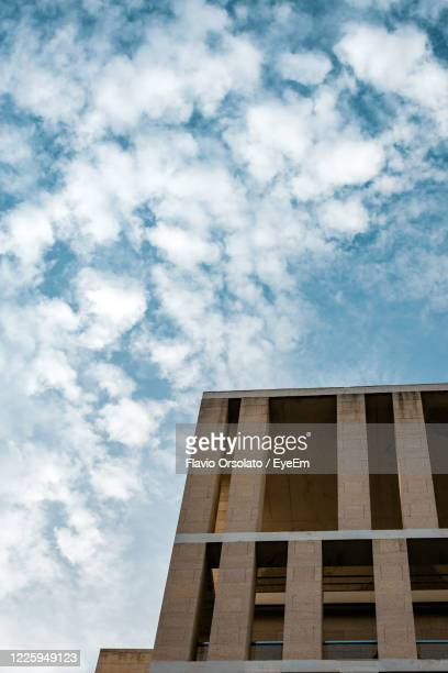 urban minimal. low angle view of building against cloudy sky - ムルシア市 ストックフォトと画像