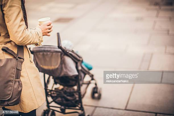 urban mom with a buggy - carriage stock pictures, royalty-free photos & images