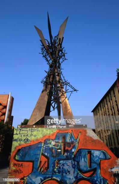 Urban monument with graffiti near Parco Sempione.