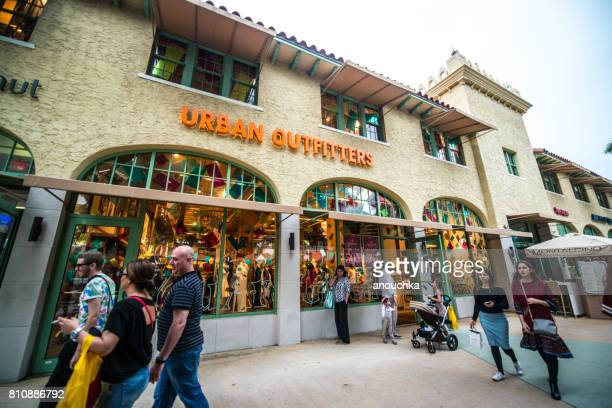 urban outfitters clothing store and sunglass hut on lincoln road, miami beach - lincoln road stock pictures, royalty-free photos & images