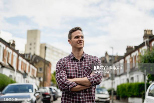 urban portrait of contented early 30s man in casual clothing - 30 34 years stock pictures, royalty-free photos & images