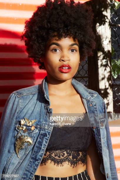 urban portrait of young female fashion blogger with afro hair, new york, usa - brooch stock pictures, royalty-free photos & images
