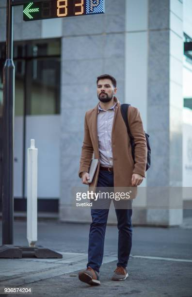 urban professional man after work - one young man only stock pictures, royalty-free photos & images