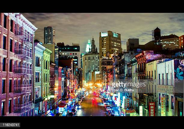 urban rainbow: east broadway at night - broadway manhattan stock photos and pictures