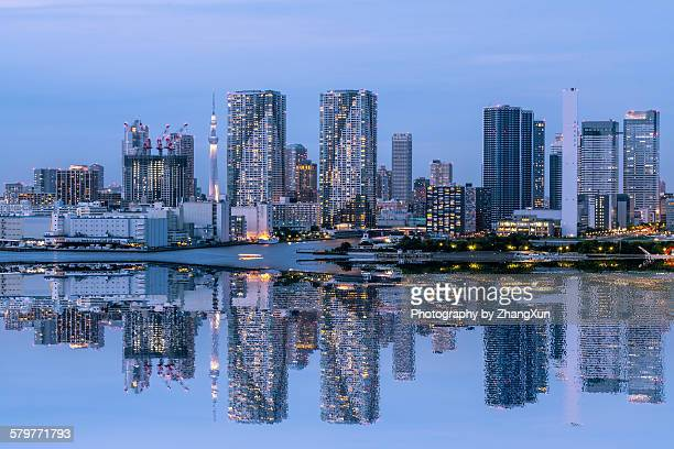 Urban reflection image at Tokyo bay at night