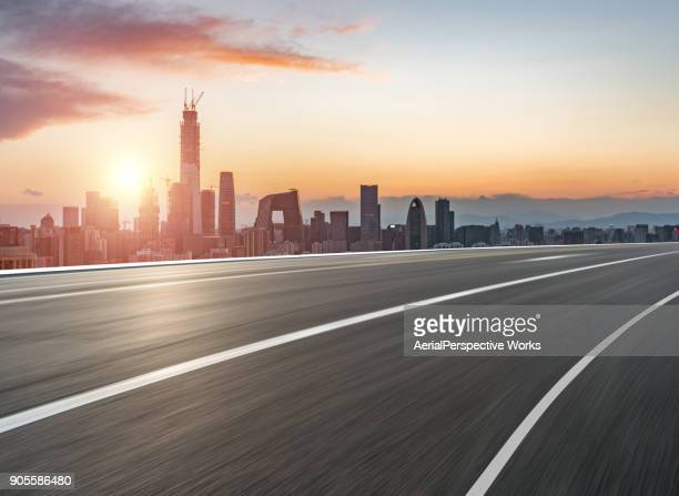 urban road in sunlight - major road stock pictures, royalty-free photos & images