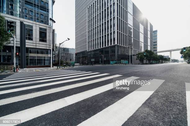 urban road - pedestrian crossing stock photos and pictures