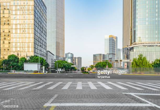urban road with road sign - zebra crossing stock pictures, royalty-free photos & images