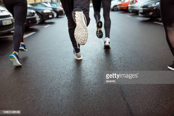 urban runner jogging on the city street - low section stock pictures, royalty-free photos & images