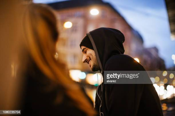 urban runners taking a break - hooded shirt stock pictures, royalty-free photos & images