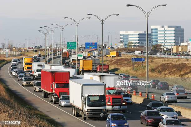 urban rush hour on highway - buzbuzzer stock pictures, royalty-free photos & images