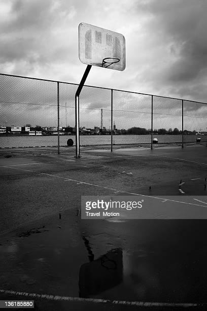 Urban scene basketball court outside, black and white